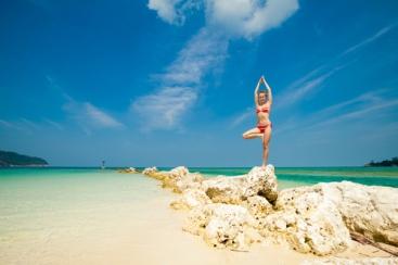 Summer yoga session on a beach