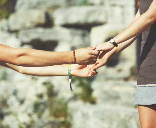 Hands of teen couple